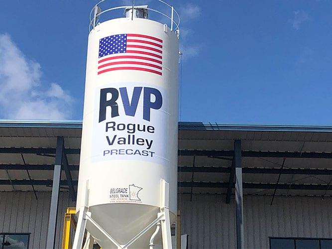 Rogue Valley Precast Company logo on a silo