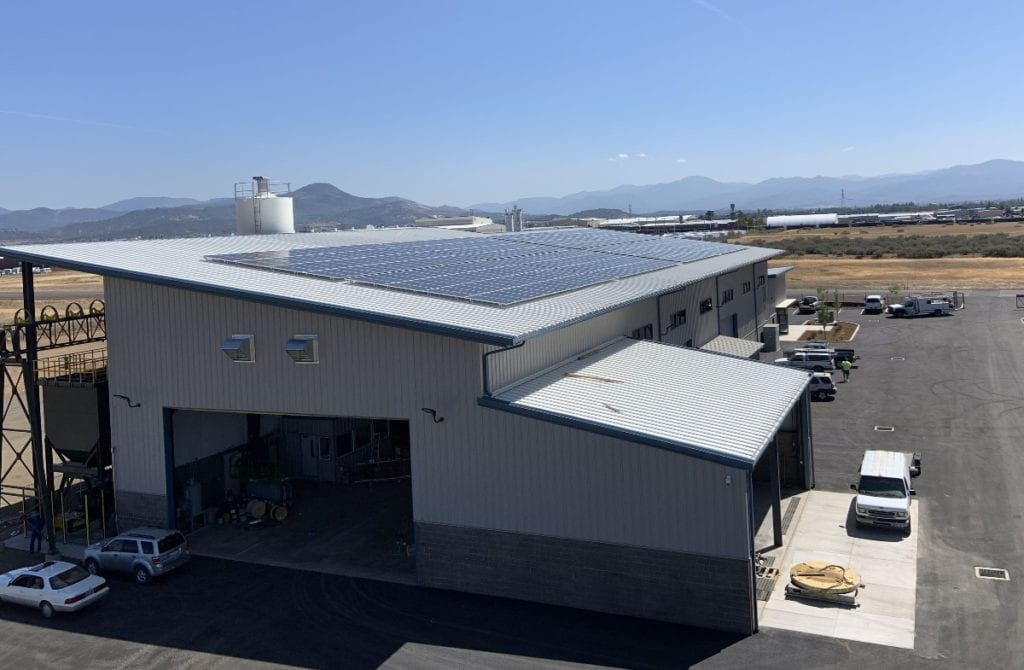 Rogue Valley Precast Concrete plant with solar panels on the roof