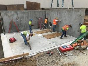 Construction of a precast concrete vault structure