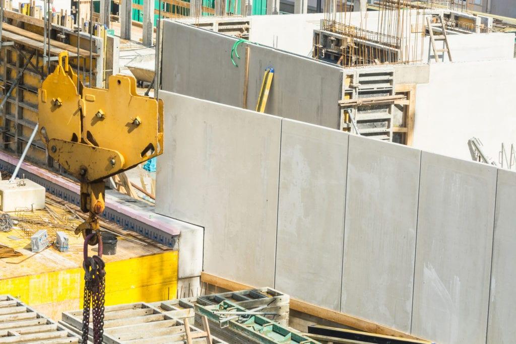Building construction with concrete walls to illustrate Precast Concrete Production Process