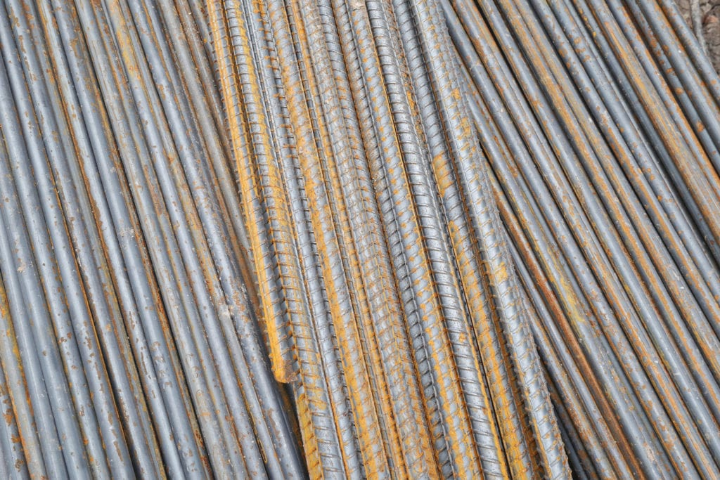 Steel rods or bars used to reinforce concrete in construction to illustrate Precast Concrete Equipment Three Essentials of Production