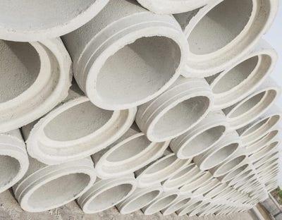 A stack of precast concrete drains